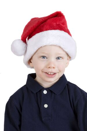 Handsome boy in santa claus hat isolated on white photo