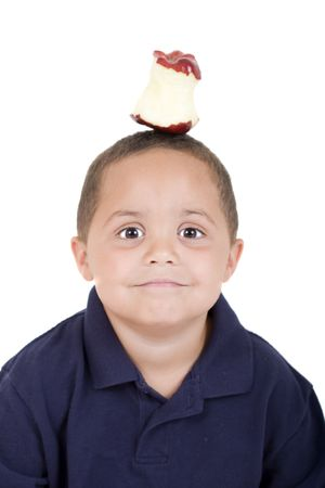 biten: Young boy with half eaten apple on his head Stock Photo