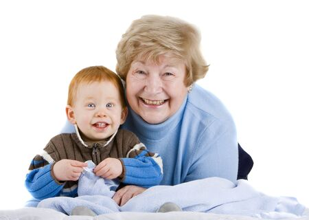 Happy grandmother with redheaded grandson sitting with blanket Stock Photo - 4100215