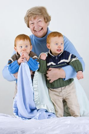 Happy grandmother with redheaded grandsons with blanket Stock Photo - 4100221