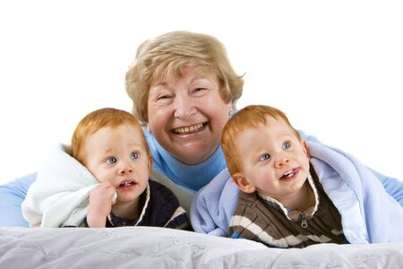 Happy grandmother with redheaded grandsons with blanket Stock Photo - 4100209