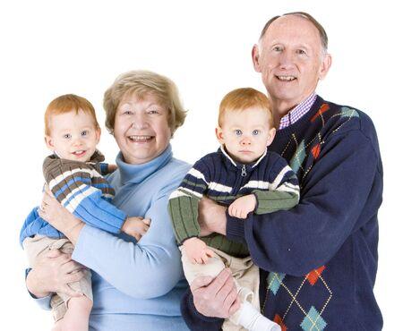 granny and grandad: Senior grandparents with twin grandsons portrait