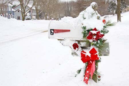 telegram: Mailbox with Christmas decorations covered in snow Stock Photo