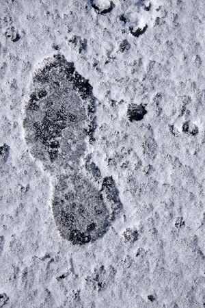 icey: One snowy footprint from a boot Stock Photo