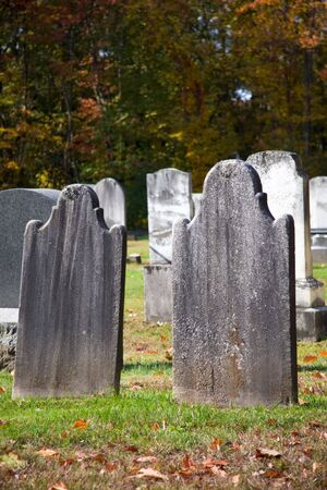 churchyard: Blank gravestone in graveyard during the autumn season Stock Photo