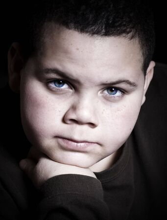 intensity: Teenage boy portrait staring at camera with intensity