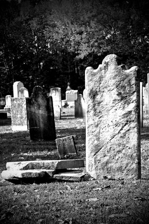 christian halloween: Old granite blank headstone in creepy churchyard Stock Photo