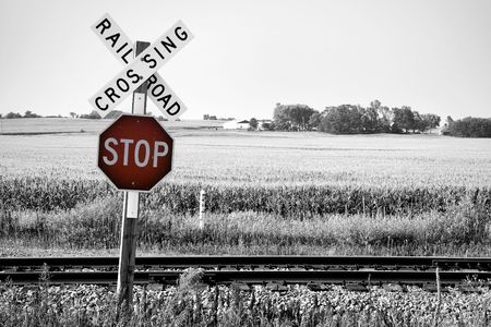 railroad crossing: Railroad crossing with stop warning sign