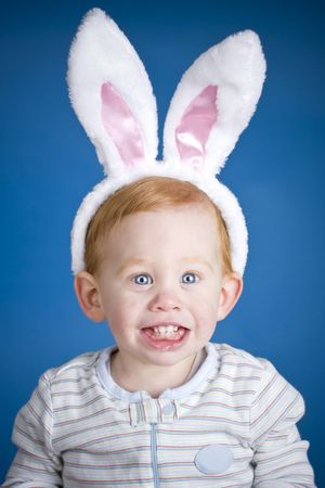 Beautiful baby wearing Easter bunny ears on head Stock Photo - 4478652