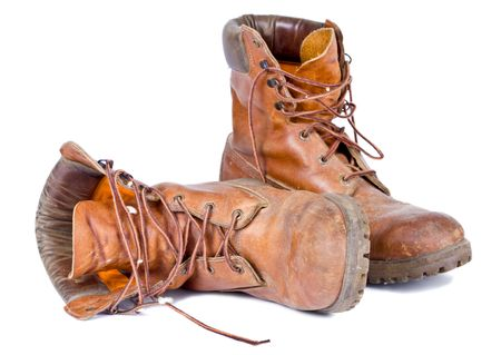 walking boots: Old worn pair of leather walking boots