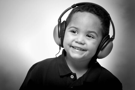Boy listening to music with headphones with grungy background photo