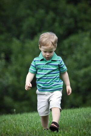 Young boy walking in garden