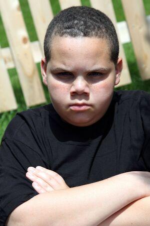 Unhappy boy outside in sunshine portrait