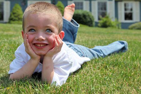 Happy boy portrait outside in sunlight Stock Photo - 5215922