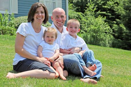 Beautiful family sitting on grass portrait Stock Photo - 5248793
