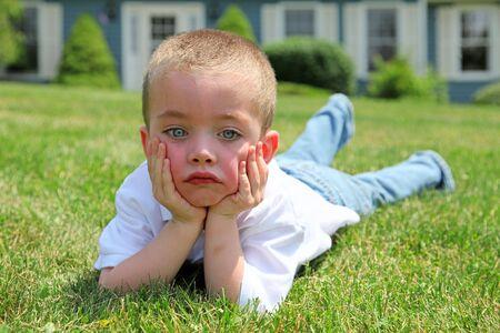 Sad boy outdoor portrait photo