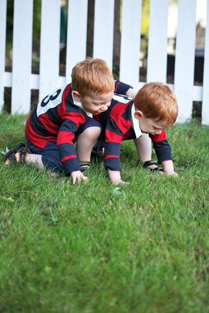 Twin baby boys playing outside photo