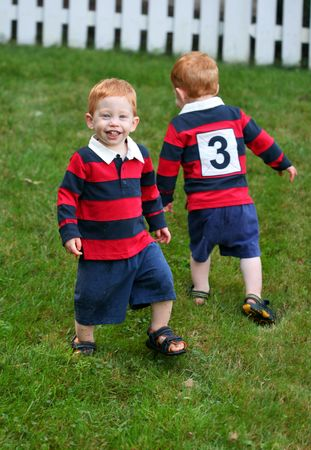 Twin baby boys playing outside Stock Photo - 5532072