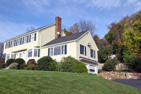 yellow house: Yellow New England Style colonial house