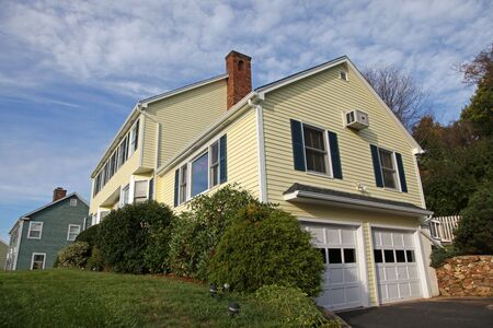 Yellow New England Style colonial house photo