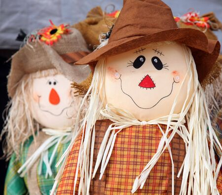 Cute scarecrow figurine used to celebrate the fall photo