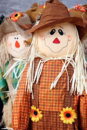Cute scarecrow figurine used to celebrate the fall photo