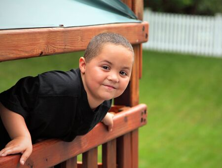 Smiling latino teen boy portrait outdoors photo