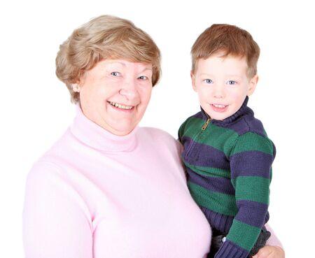 Happy grandma holding her handsome grandson photo