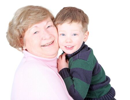 Grandmother hugging handsome grandson isolated on white photo