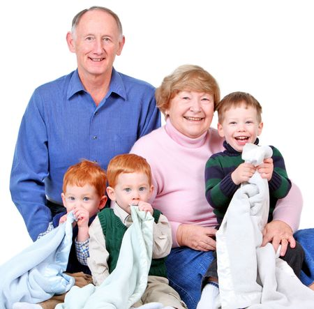 Happy grandparents with three handsome grandsons photo