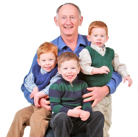 Happy grandpa with three handsome grandsons Stock Photo - 6201275