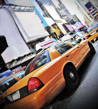 yellow: Yellow Cab in high contrast color and vignette speeding through Times Square New York