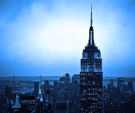 New York City skyline at sunset with blue hue