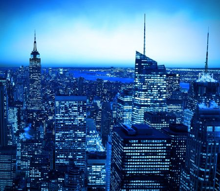 New York City skyline at night with blue hue