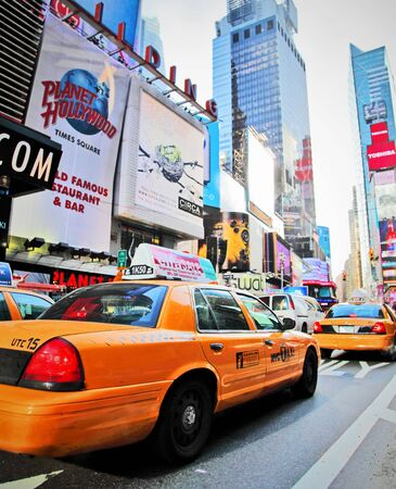 NEW YORK - DECEMBER 29: Yellow cab speeds through Times Square landmark during run up preparations for New Years Eve event on Dec 29, 2009 in New York, NY, USA. Stock Photo - 6886341