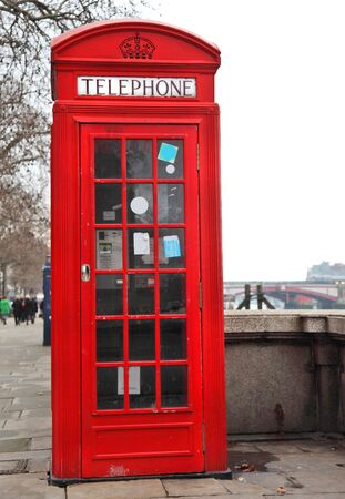 telephone: Red Telephone Box London next to River Thames  Stock Photo