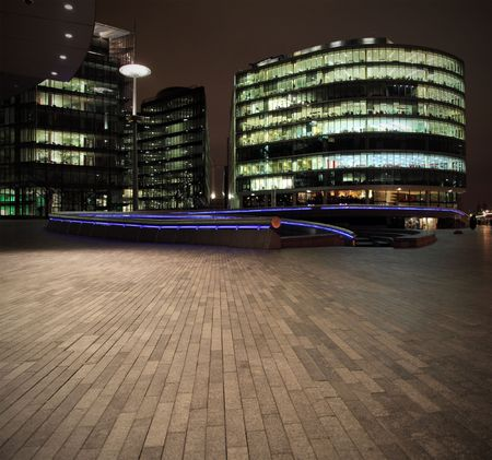 contemporary: Urban scene with offices at night