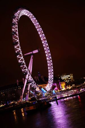 voted: LONDON - JANUARY 23: Millennium Wheel and Thames River on January 23, 2009 in London. It was voted top tourist hot spot in the UK by Best of Britain & Ireland 2009.
