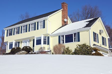 snow drift: Traditional American colonial style house in winter Stock Photo