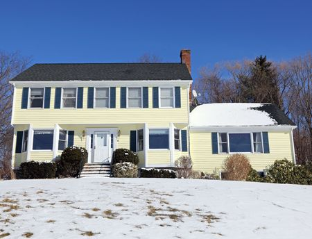 colonial building: Traditional American colonial style house in winter Stock Photo
