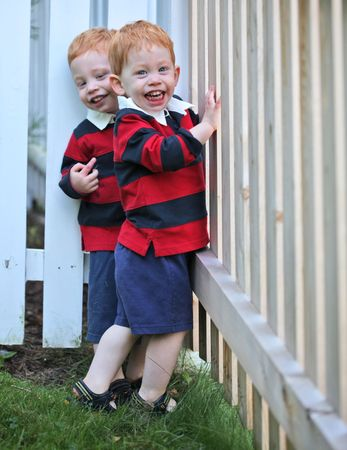 Happy twin boys wearing rugby shirts photo