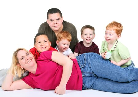 foster parenting: Woman with five mixed race children reclining on white background Stock Photo