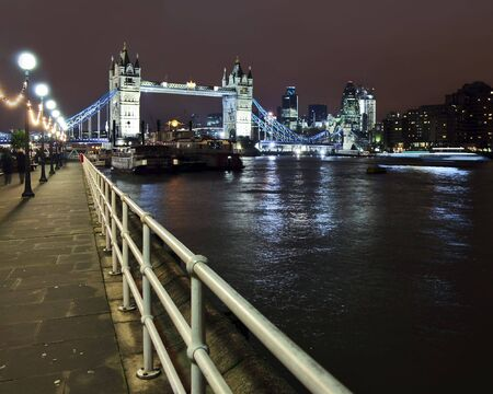 Tower Bridge at night in London, England photo