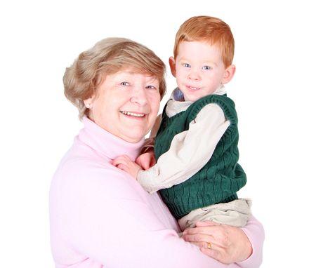 Grandmother holding a happy grandson studio portrait photo