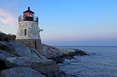 beacon: Castle Hill Lighthouse in Newport Rhode Island at sunrise