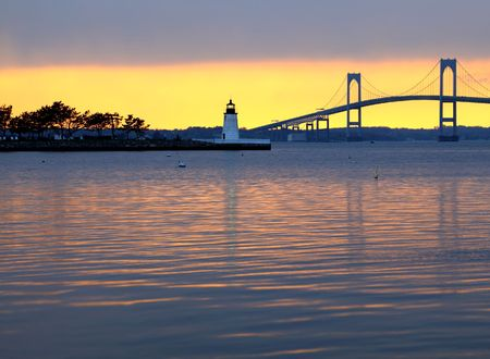 bridge over water: Beautiful sunset over bridge and lighthouse in Newport, Rhode Island Stock Photo