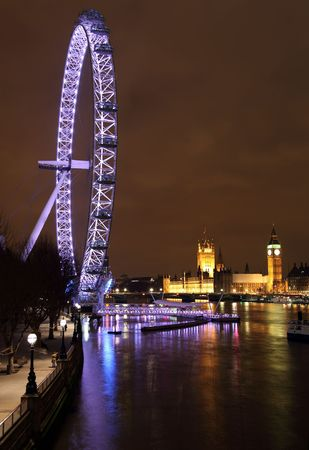 nightime: LONDON - JANUARY 23: Millennium Wheel and Thames River on January 23, 2009 in London. It was voted top tourist hot spot in the UK by Best of Britain & Ireland 2009.  Editorial