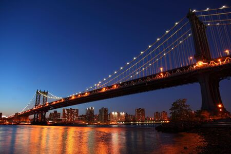Sunset over historic manhattan Bridge in New York City