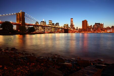 Sunset over historic Brooklyn Bridge in New York City photo