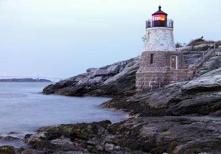 newport: Castle Hill Lighthouse in Newport Rhode Island at sunset Stock Photo